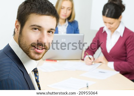 Businessman and his team - stock photo