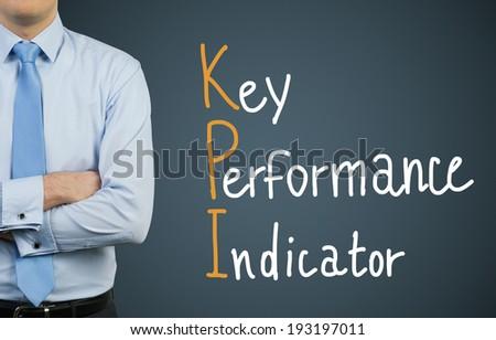Businessman and KPI. Dark background. - stock photo