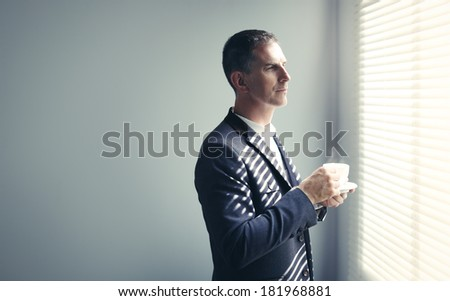 Businessman and morning coffee - stock photo