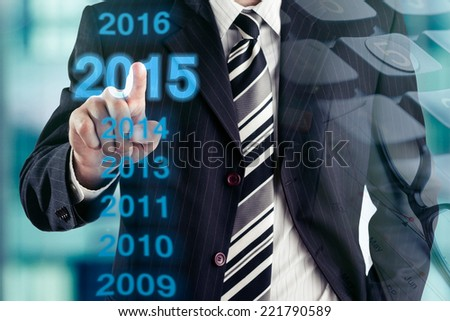 Businessman and number of new year 2015. Finance concept. - stock photo