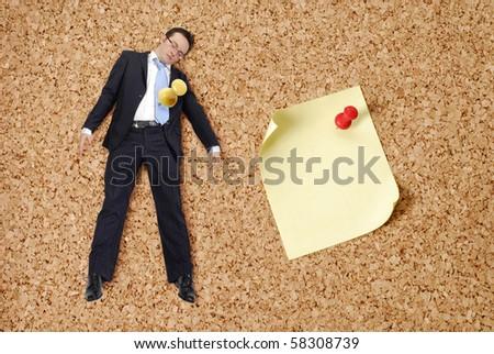 businessman and push pin on bulletin board. - stock photo