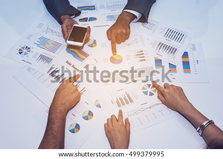 Businessman and Team Discuss about Business with Sale Report to