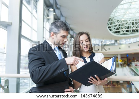 Businessman and woman discussing work