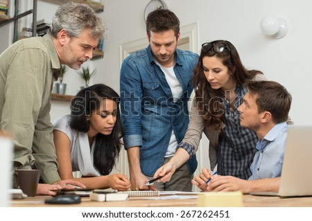 Businessman and woman doing discussion at table in office  - stock photo