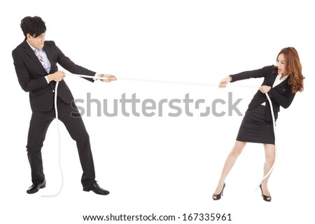 businessman and woman playing tug of  war - stock photo