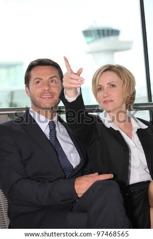 Businessman and woman pointing - stock photo