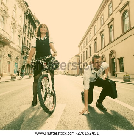 Businessman and woman ready to race - stock photo
