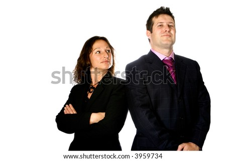 Businessman and woman standing next to each other, body facing opposite direction suggesting presence of jealousy or corporate competition in workplace. - stock photo