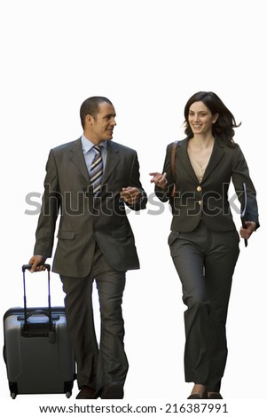 Businessman and woman walking with luggage, smiling, cut out