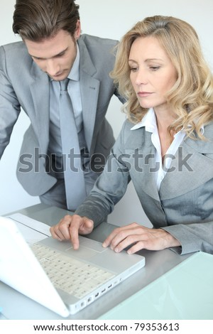 businessman and woman with laptop - stock photo