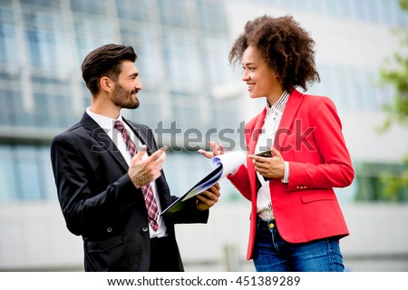 Businessman and woman with tablet computer ,talking - stock photo