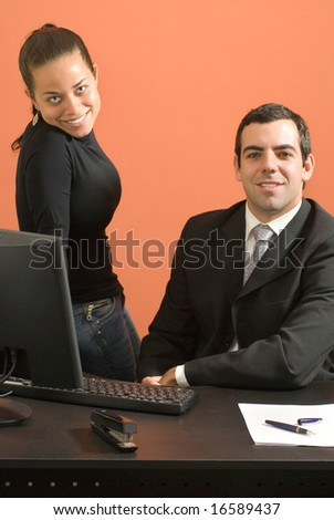 Businessman and woman working - stock photo