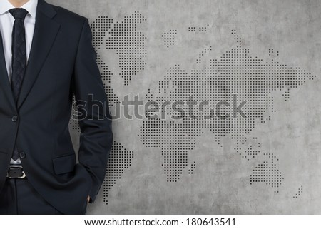 Businessman and world background wall (grey) - stock photo