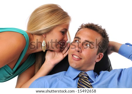 Businessman and young woman whispering secrets against a white background - stock photo