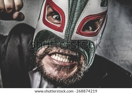 businessman angry with Mexican wrestler mask - stock photo