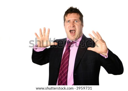 Businessman appearing shocked, fingers splayed apart, mouth wide open. - stock photo