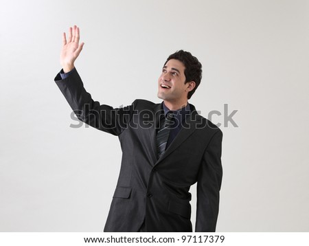 businessman arm raised waving in the air - stock photo