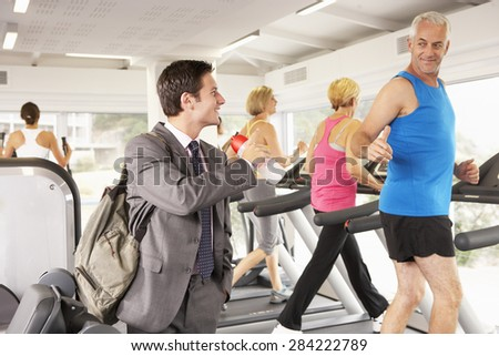 Businessman Arriving At Gym After Work - stock photo