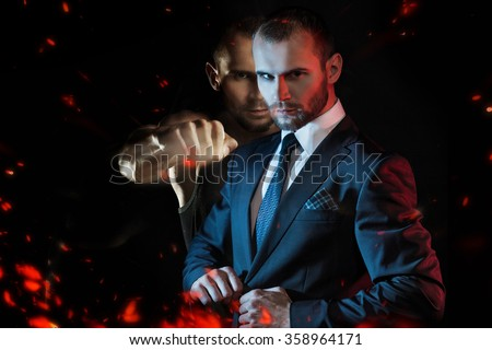 Businessman as an athlete fighter, alter ego aggressive businessman - stock photo