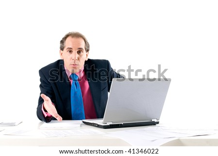 Businessman asking for explanations with laptop on white background.