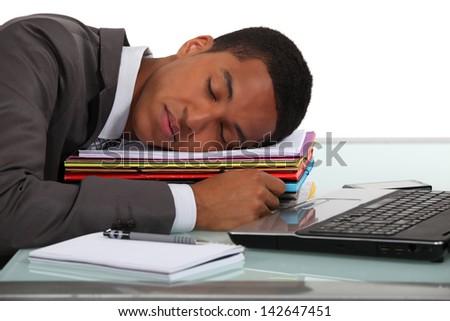 Businessman asleep at his desk - stock photo