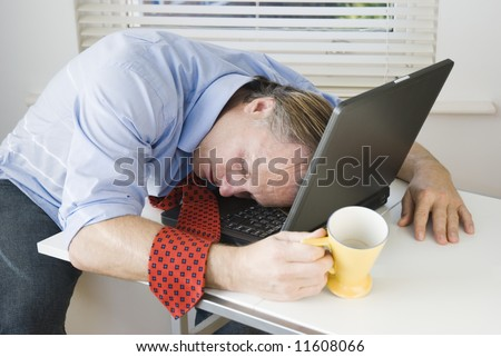 businessman asleep on laptop. - stock photo