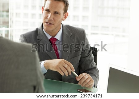 Businessman at a Business Meeting - stock photo