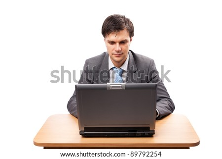 Businessman at his desk with a laptop, isolated on white background