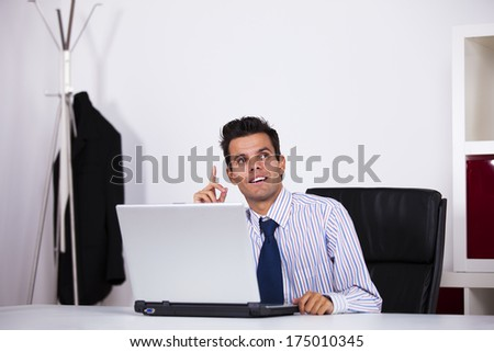 Businessman at his office working with his laptop