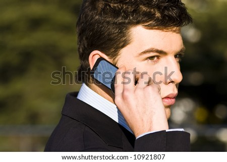 Businessman  at phone, colorful image. - stock photo