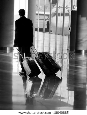 Businessman at the airport - stock photo