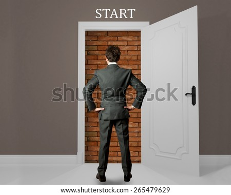 Businessman at the beginning of opportunity hampered - stock photo