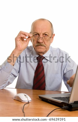Businessman at the computer isolated on white background - stock photo