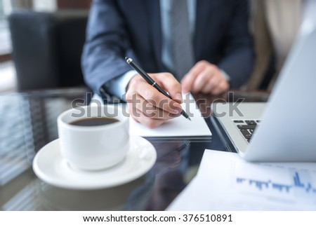 Businessman at the desk with documents