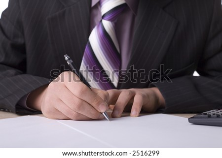 Businessman at the desk with signing agreement.