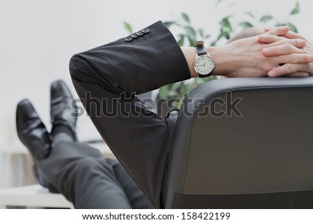 Businessman at the end of the work in his office
