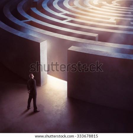 Businessman at the entrance a circular maze - stock photo