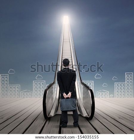 Businessman at the escalator with cityscape drawing - stock photo