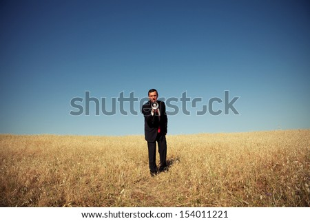 businessman at the field shouting at the megaphone to you - stock photo