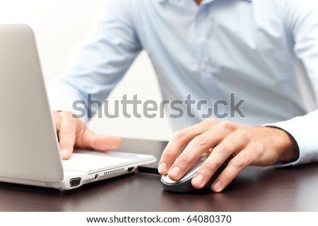 Businessman at the notebook - stock photo