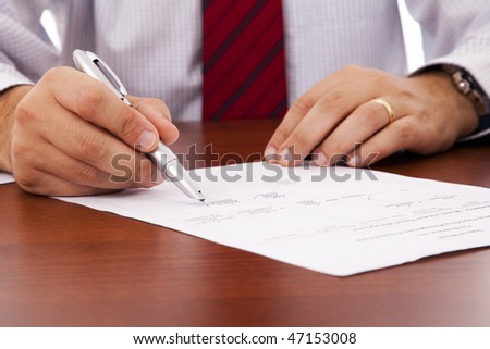 businessman at the office signing a contract - stock photo