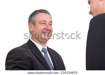 Businessman at the welcome of a Young Man - stock photo