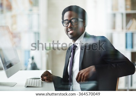 Businessman at workplace - stock photo