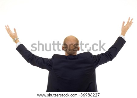 businessman back praying with his arms up