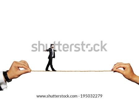 businessman balancing on the rope. isolated on white background - stock photo