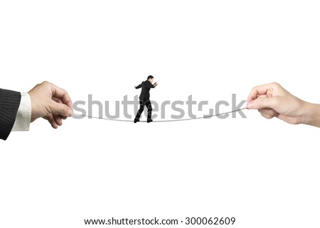 Businessman balancing on tightrope with man and woman hands holding two sides, isolated on white. - stock photo