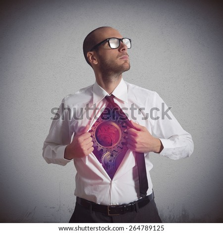 Businessman becomes a super hero of gear - stock photo