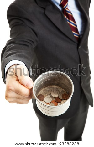 Businessman begging for change in his tin cup.  White background. - stock photo