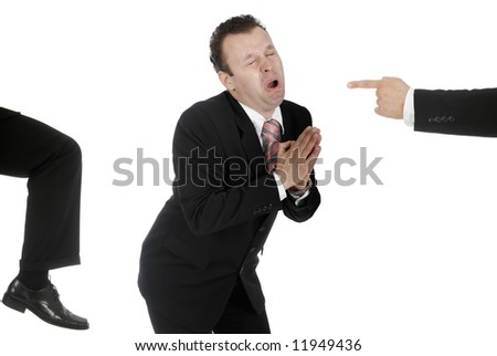Businessman begging for work as he gets kicked - stock photo