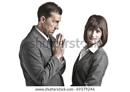 Businessman begging to a businesswoman - stock photo